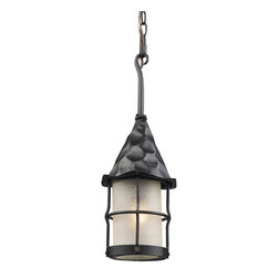 Elk - Rustica 1-Light Outdoor Pendant in Matte Black with Scavo Glass - Bring storybook flair to an old English, cottage or Spanish revival-style home with the rustica collection. Hand-hammered iron and scavo seedy-glass cylinders characterize this series, which may be ordered in matte black (Bk) with white scavo glass and antique copper (Ac) with amber scavo glass. They may be used in both indoor and outdoor locations. (Ul Listed).