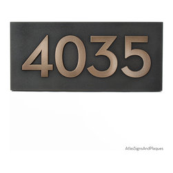 "Neutraface Address Plaque 15.5"" x 7"" in Bronze Patina - The Neutraface Address Plaque derives its name from the typeface designed by the forward looking architect, Richard Neutra. Neutra introduced big-building concepts to residential homes with such modern elements as floor to ceiling glass walls, roof top reflecting pools, and steel framing. His typeface is true to his modernistic style with its strong, very geometric, sans-serif design. It fits both modern, and neo-modern designs and is a grand fit for buildings and spaces with strong modern angular elements. This is the same font that you will find at Design Within Reach (DWR)."