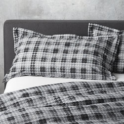 Linde King Sham - Italian-made linens nod to menswear chic, exaggerating the classic houndstooth in brilliant, lasting color for a graphic, contemporary classic. Cotton fabric is treated to a special finish for an extra-soft hand feel. Shams have overlapping flap closures. Bed pillows also available.