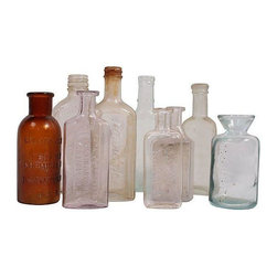 "Used Vintage Medical Bottles - Set of 9 - Various medical bottles - a ready-made collection! Includes nine different bottles. Largest measures 2.5""L X 1.5""W X 6.5""H and smallest measures 2""L X 1""W X4.5""H."