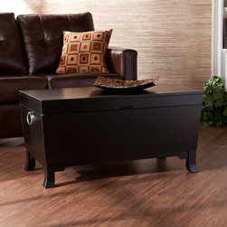 Upton Home - Parsons Black Coffee/ Cocktail Table Trunk - This convenient black coffee table brings a lot of extra storage space to any room. Its pedestal feet and silvertone handles add to its elegant look. With its dark color and modern style, the coffee table goes well with just about any decor.