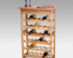 Catskill - Detroit 36-Bottle Floor Standing Wine Rack Multicolor - 7237 - Shop for Wine Bottle Holders and Racks from Hayneedle.com! What We Like About This Wine RackThe Detroit Wine Rack is made of solid hardwood with a fully oiled natural finish. This wooden rack has six rows of bottle storage for a total capacity of 36 bottles. The slight tilt ensures that corks remain wet. A handy utility drawer above the bottles provides storage for corkscrews or utensils. The top of this rack measures 24W by 13D inches and has been lacquered for protection making it the ideal place to serve wine at your next party. Catskill Craftsmen's Eco-friendly PracticesCatskill Craftsmen is committed to protecting the environment through responsible forest management and manufacturing practices. Located in the Catskill Mountains of upper state New York Catskill Craftsmen plays a role in maintaining the health of the New York City watershed. This watershed provides clean water for New York City and other communities in the area. Healthy well-managed forests are better able to filter pollutants from entering streams and rivers which preserves the quality of watershed resources. With this goal in mind the company supports the efforts of the Watershed Agricultural Council (WAC). With the WAC Catskill Craftsmen encourages lumber suppliers (family forest owners and public land managers) to make wise harvesting decisions and control erosion in order to safeguard water quality. Other efforts to protect the environment include using sustainable wood sources and reducing wood waste. Catskill Craftsmen's manufactured items are made from naturally self-sustaining non-endangered North American hardwoods primarily birch and hard rock maple. All sawdust shavings and waste materials generated during the manufacturing process are converted into wood pellet fuel used to heat homes. This alternative heating source creates less ash and lower emissions than some other fuels. By operating their own wood pellet mill Catskill Craftsmen reduces their wood waste to zero. As natural resources become even more valuable Catskill Craftsmen will continue to advance proper stewardship of the pristine Catskill Mountain region. About Catskill CraftsmenFor over 60 years Catskill Craftsmen has provided customers with high-quality domestic hardwood ready-to-assemble products. Located in Stamford New York Catskill Craftsmen manufactures kitchen carts islands work centers gourmet butcher block chopping blocks cutting boards hardwood cabinets furniture book carts and racks. Catskill Craftsmen is recognized as the nation's leading manufacturer of premium wooden products.