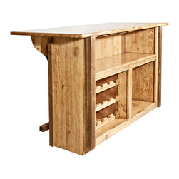 Montana Woodworks - Montana Woodworks Homestead Deluxe Bar with Foot Rail Stained and Lacquered - From Montana Woodworks  the largest manufacturer of handcrafted  heirloom quality rustic furnishings in America comes the Homestead Collection line of furniture products.  Handcrafted in the mountains of Montana using solid  American grown wood  the artisans rough saw all the timbers and accessory trim pieces for a look uniquely reminiscent of the timber-framed homes once found on the American frontier.  Similar in design to the standard bar with foot rail  this deluxe version comes complete with a 15 bottle capacity wine rack and built in glass racks.  Comes completely assembled. 20-year limited warranty included at no additional charge.