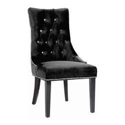 Armen Living - Armen Living Carlyle Button Tufted Dining Side Chair - Black - LCF024TUSIBL - Shop for Dining Chairs from Hayneedle.com! Modern elegance is easy to obtain when you feature the Armen Living Carlyle Button Tufted Dining Side Chair - Black at your dining table. The clean contemporary lines and soft black upholstery create a dramatic flair. Details like a tufted back and nail head accents provide the perfect complement to your decor adding luxury without pretention. About Armen LivingImagine furniture without limits - youthful robust refined exuding self-expression at every angle. These are the tenets Armen Living's designers abide by when creating their modern furniture collections. Building on more than 30 years of industry experience Armen Living combines functional versatility and expert craftsmanship into their dramatic furniture styles all offered at price points fit for discriminating budgets. Product categories include bar stools club chairs dining tables ottomans sofas and more. Armen Living is based in Sun Valley Calif.