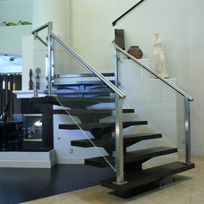 Contemporary Staircase by AP Metal Designs