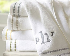 "Pearl Embroidered Hand Towel, Thyme Green - An embroidered string of pearls borrowed from our Pearl Embroidered Bedding punctuates our 700-gram cotton towels. Dotted with satin-stitched pearls. See available colors below. Machine wash. Oeko-Tex certified, the world's definitive certification for ecologically safe textiles. Catalog / Internet Only. Made in Portugal. Monogramming is available at an additional charge. Monogram is 3"" and will be centered at one end of the bath and the hand towels."