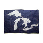 Haptic Lab - Soft-Map Great Lakes Quilt - From the deep blue cotton background to the hand-applied lakes to the hand-stitched cities and mountains, this quilt is truly Great. Hand-stitched on 100 percent fair trade cotton. When the wind blows cold and Erie, this Superior quilted throw will keep you warm.