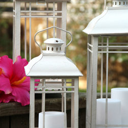 """Antique White Candle Lanterns - Nothing says """"summer"""" like a good ol' barbecue! When those long summer nights come around, you can make them last even longer with some outdoor lanterns."""
