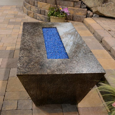 Fire Pits - Great for Fall and Winter - For a dramatic presentation in a contemporary setting and a cozy centerpiece on a patio or deck, there's the Parallax rectangular fire pit table from R&R Living. This self-contained 90,000 BTUs rectangular fire pit table is a piece of modern art. It's beautifully designed and handcrafted from recycled steel and a trademark Parallax Armor coating, which is engineered to be resistant to fading, rust and corrosion. You can choose from 12 different finishes that are scratch-, UV- and heat-resistant up to 400 degrees, in addition to being easy to clean. The Copper Vein, Oil Rubbed Bronze, and Silver Vein finishes are recommended for coastal salt air locations.