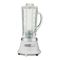 Waring Pro - Waring Pro PBB201 Professional Food & Beverage Blender - PBB201 - Shop for Blenders from Hayneedle.com! Mix things up with the Waring Pro PBB201 Professional Food & Beverage Blender. This innovative spin on a classic is uniquely industrious. A powerful 390-watt output motor creates tons of culinary and entertainment options - crush ice blend drinks puree soups mix dips. You name it with a 5-cup capacity this blender does it all. An easy-to-use toggle switch makes switching modes a breeze.Additional features:Made in the USAComplete with a 6-foot power cord so blender can be used almost anywhereNon-slip rubber feet prevent spills and accidentsRemovable stainless steel blade for easy cleaning - simply wipe down with soap and waterDurable glass carafe is dishwasher-safeRubber lid with plastic 1-ounce measuring insert and blade assembly seal - hand wash onlyClassic white baked enamel finishStandard 1-year product and service warranty; 5-year motor warrantyAbout WaringIf you've ever used a blender you can thank Fred Waring inventor of the blendor or as he first called it the disintegrating mixer. That was back in 1936. Since then he has changed the name to blender and established Waring a global company that proudly makes professional-quality kitchen products. The company has two product divisions: Waring Pro and a commercial division. In recent years Waring Pro has broadened its market reach with everything from deep fryers and waffle makers to wine chillers and food dehydrators.