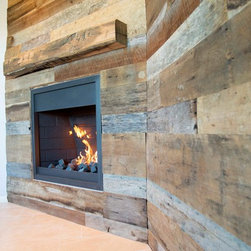 Wall Covering - Mixed Tobacco Barn Wood with Hand Hewn Oak Mantle - -Close-up Angled View of Fireplace and Mantle-