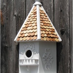 Home Bazaar Rapunzel House Birdhouse - You can ask that the occupants let down their hair, but the birds living in the Rapunzel House will be too comfortable to bother. A simple design with delicate scrollwork and pine shingles will be a fine touch to any yard. The keyhole back will allow for easy placement. A removable back wall will make cleaning simple, so you can spend the rest of your time enjoying your little slice of storybook bliss.About Home BazaarCombining their love of birds and nature with their technical and design abilities, the people of Home Bazaar set out to create the world's most spectacular line of birdhouses and birdfeeders in 1999. They've even created a line of architectural birdhouses, feeders, pedestals, and garden accessories. These items are created using only the finest materials and with painstaking attention to detail. Each product is manufactured for functional use and to be enjoyed for years. Distinctive bird houses and feeders can be matched with accommodating pedestals and these pieces can be placed in the backyard or the garden. Cottage designs and pieces with Victorian scrollwork often end up on covered porches or inside the home as decorative accents.