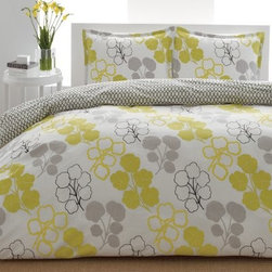 City Scene Pressed Flower Reversible Duvet Bedding Set - The City Scene Pressed Flower Reversible Duvet Bedding Set offers a bright cheery demeanor that's perfect for your sunlit bedroom. The duvet included in this set features a 100% polyester filling that helps retain warmth and provide plush comfort. The white background of the duvet features a yellow gray and black-outlined white floral pattern with simple black-and-white link pattern on the reverse. Matching pillow shams are included (2 for the king/queen sets; 1 for the twin set). Each piece is machine-washable. Quilt Dimensions: Twin: 68L x 86W inches Full/Queen: 88L x 88W inches King: 104L x 88W inches About City SceneCity Scene bedding will add sophisticated style to your bedroom. Unique patterns vivid colors quality materials and attention to detail help City Scene's bedding products give your room a designer flair. And their careful craftsmanship means their bedding will keep your room beautiful for years.
