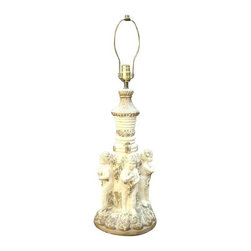 "Used Gold Gilt White Italian Ceramic Putti Cherub Lamp - An exquisite antique Italian ceramic table lamp. The lamp features a gold gilt finish over white Italian ceramic with 4 putti cherubs adorning the base.    The height base to top of sculpture: 21"" height to top of lampshade screw: 31.5"" base width: 9.75"" height of cherubs bottom of feet to top of head : 8.75"" weight: 10lbs."