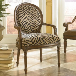 "Hammary Ashby Accent Chair - The Hammary Ashby Accent Chair is a fun and stylish chair that will add a bold pop to any room in your home. The black and light brown zebra fabric is made with a soft chenille.About Hammary Furniture CompanyHammary Furniture Company, a division of La-Z-Boy Incorporated, offers a variety of styles in occasional tables, home office, casual dining, and bedroom. Hammary products are available in the United States and Canada, as well as other countries.Hammary Furniture Company was started in October 1943 by Hamilton Louden Bruce. The name """"Hammary"""" derived from Hamilton's name and his wife's name, Mary. Mr. Bruce leased a small space and hired two helpers to begin production of canvas lawn chairs. In late 1947, Mr. Bruce began manufacturing occasional tables, and the company expanded from there."