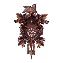 River City Clocks - River City Seven Hand-Carved Maple Leaves and Three Birds Cuckoo Clock - This traditionally styled German quartz cuckoo clock features wooden hands, a wood dial with Roman numerals, and a warm light yellow hand-painted and hand-carved cuckoo bird. The cuckoo clock case features seven hand-carved maple leaves and three birds. Two cast iron pine cone weights are suspended beneath the clock case by two separate brass chains.