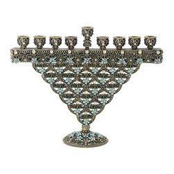 Frontgate - Sinclair Crystal Menorah - Cast pewter Hanukkah menorah. Hand-set with dozens of topaz, blue, and jonquil Swarovski® crystals. Antique brass finish. Heirloom quality. Clean with soft, dry cloth. The distinctive tapered design of the Sinclair Crystal menorah is illuminated by blue and topaz crystal florets. Made from cast pewter with antique brass finish, this menorah brings cultured refinement to Hanukkah festivities. A flattering addition of heirloom quality to religious holiday celebrations.  . Hand-set with dozens of topaz, blue, and jonquil Swarovski crystals .  .  .  . 80% pewter, 20% Swarovski crystals . Imported.