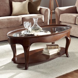American Drew Cherry Grove Oval Coffee Table - Feel slightly presidential with American Drew Cherry Grove Oval Coffee Table. Enhance your living room with executive style, crafted of high-quality engineered wood, finished in an exquisite antique cherry finish, and equipped with a display shelf.About American DrewFounded in 1927, American Drew is a well-established, leading manufacturer of medium- to upper-medium-priced bedroom, dining room, and occasional furniture. American Drew's product collections cover a broad variety of style categories including traditional, transitional, and contemporary. Their collections range from the legendary 18th-century traditional Cherry Grove, celebrating its 42nd year of success, to the extremely popular Bob Mackie Home Collection, influenced by the world-renowned fashion designer Bob Mackie. Jessica McClintock Home features another beloved designer bringing unique style to an American Drew line. American Drew's headquarters are located in Greensboro, N.C. Their products are distributed through thousands of independently owned retailers throughout the United States and Canada and around the world.
