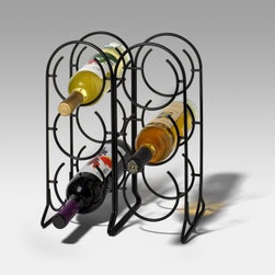 """Spectrum Horseshoe 6-Bottle Wine Rack - Black - The Spectrum Horseshoe 6 Bottle Wine Rack - Black gives you an excuse to break out a great bottle at your next dinner party - or just because. You'll love how easy it is to store and display your favorite wines with this metal rack. Two arched columns contain semi-circle shaped """"""""horseshoe"""""""" holders each designed to support a single bottle in two places (the body and neck). The result is efficient storage of up to six bottles on your table or countertop. A sleek black finish adds to the modern look too. This rack measures 11.5L x 6.75W x 14.75H inches."""