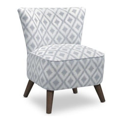 Ikat Fret Pewter Chair - Cool and contemporary, the Ikat Fret Pewter Chair offers an irresistible accent to any room. Its thick padded seat is upholstered in a cotton and poly blend with a popular ikat print in pewter. Round, flared legs and a tapered back offer an eye-catching, angular design.About Skyline Furniture Manufacturing Inc.Skyline Furniture was founded in 1948 with the goal of producing stylish, affordable, quality furniture for the home. After more than 50 years, this family-run business is still designing and manufacturing unique products that meet the ever-changing demands of the modern home furnishing industry. Located in the south suburbs of Chicago, the company produces a wide variety of innovative products for the home, including chairs, headboards, benches, and coffee tables.