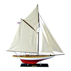 Handcrafted Nautical Decor - Vigilant Limited 35'' - NOT A MODEL SHIP KIT--Attach Sails and the Vigilant model yacht is Ready for Immediate Display ----This elegant model yacht of America's Cup winner Vigilant is the perfect highlight for a bedroom or beach house, office or meeting room while sailing from atop any mantle, shelf or table. Brightening any room with her presence, Vigilant model sailboats shine with the unbound freedom of the wind, graceful speed of the waves and winning spirit of their famous namesake in this Limited Edition model yacht. --32'' L x 4'' W x 35'' H (1:49 scale) ----    Accurate      museum-quality scale replica of the real      Vigilant racing yacht--    Individual plank      on frame      construction of the hull using fine quality woods, with each plank and      wood grain visible through the paint--    High quality craftsmanship and details, including:--    --        Increased details and items on       deck compared to standard models--        Brass wire railing running       along gunwales--        Clear window panes in all       deckhouses--        Lifeboat with accurate design and       curved bottom--        Accurate scale of all deck and       hull components--        Thick, sturdy canvas used for       all sails--    --    --    Limited      production run only 50 of these model sail boats--    Significant      research to guarantee accuracy of this yacht model includes sources such as photos,      historical plans and original artwork--    Pre-assembled, simply attach the masts and      display--    --        Ready to display in less than       five minutes--        Separate pre-assembled hull       and sails ensure safe shipping and lower cost--        Insert mast in designated hole       and clip brass rigging hooks as shown in illustrations--        Sails and rigging already       complete--    --    --