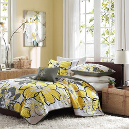 MiZone - Mizone Mackenzie Quilt Set Multicolor - MZ80-067 - Shop for Bedding Sets from Hayneedle.com! Add a pop of color to your dorm room with the Mizone Mackenzie Quilt Set. Bright yellow and grey come together in an oversized floral pattern you'll love. This 100% polyester quilt set will surround you in comfort and is conveniently machine-washable. It's offered in a variety of sizes. Your set comes with the quilt either one or two pillow shams and a decorative pillow.Quilt Dimensions:Twin/twin XL: 68 x 90 in.Full/queen: 86 x 90 in.