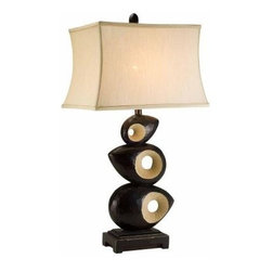 ORE International - Black Bedside Lamps: 33 in. Black African Craft Table Lamp K-4221T - Shop for Lighting & Fans at The Home Depot. This is a unique African crafted table lamp. Features three almond-shaped pieces stuck together with unique circular designs in the center. This lamp has a dark wooden color with accents of beige.