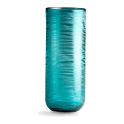 Libra Vase - Large - Etched glass in a regular horizontal pattern creates a sleek cylinder, the Large Libra Vase. With clean lines suited to the transitional, minimalist interior, this high-end glass vase is tinted a light turquoise which takes on an almost pearly effect when its shifting textures are viewed from a distance. Faintly organic lines in the controlled shape soften the precision of the vase.