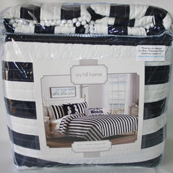 Navy Cabana Striped Bedding - This cabana striped quilt set is fresh, crisp and perfect for nautical or seaside style.  Wide navy and white stripes have a casual chic and contemporary beach look which will set the stage for any coastal decor.  White pom-pom fringe around the quilt and shams adds nautical charm and a decorator's touch.  The coordinating accent pillow is made of bright white, 100% cotton and decorated with a navy blue starfish and silver accent beading.