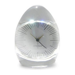 EcoFirstArt - Dada Pressed Glass Clock - Well, hello, Dali. This contemporary clock features traditional clock workings behind optical glass cast in an egg shape to magnify and distort the face in slightly surreal ways.