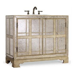 "Cole & Co. - Cole & Co. 43"" Designer Series Victoria Chest - Antique Mirrored - Cole & Company combines great design with great flexibility, allowing you to mix and match size, finish, and style to create your own perfect bathroom vanity. The elegant Victoria Chest is sure to bring out the glamour in any bathroom with it classic mirrored finish and subtle overlay pattern. Glamour meets the familiar as a mirrored finish is combined with natural oak accents. Featuring two adjustable shelves behind two doors. Individually handmade of Asian hardwood solids and select oak veneers with Antique Mirror.Cole & Co. has offered its famous Designer Series since 1998 and is among the most popular and well-known is the US. Featured is almost every major design and interiors magazine, each handcrafted furniture piece in the Designer Series has the back cut out by hand for plumbing and sink installation and door or drawers configured to retain usefulness and storage capabilities. Designer Series vanities come with the wooden tops as shown to replicate a fine piece of furniture much the same way fine antiques have been converted as vanities in this way for years. Each piece is thoughtfully configured for ease in plumbing installation.When purchasing Cole & Co. vanities, you will have peace of mind that you're choosing furnishings of enduring quality. Caring craftsmen pay attention to every detail such as: All drawers include wood-on-wood glides for smooth, efficient operation, and all touching drawer guide parts are waxed for smooth and quiet operation; Strength and durability are supplied by mortise and case construction reinforced with glue and metal fasteners; Solid lumber and select wood veneers are carefully chosen to permit consistent finishing as use of veneers enables more decorative looks unattainable with solid wood. Veneers, which are used only on flat surface areas such as the case tops and sides, also add weight, strength and dimensional stability; and lastly, Up to 30 finishing steps, including 13 steps of hand-sanding and accenting are used with physical distressing done by hand to insure an authentic, antique look. In addition, all items receive two to three full coats of catalyzed lacquer for extra depth and durability and a final top coat of nitrocellulose to help protect it from wear, water and light.Your Cole & Co. quality vanity is a significant investment expected to last for generations. To maintain its beauty and help it last, please refer to the Designer Series product information sheet and the Care & Cleaning FAQ. Each piece is handmade and finished and actual color may vary. Features: Completely hand madeAntique Brass HardwareFeatures two adjustable shelves behind two doors43-3/4""W x 19-3/4""D x 36-1/4""HFaucet(s) not includedSink(s) not included Ships with wooden topPlease confirm sink measurements will work prior to ordering. Cole & Co. can custom cut your vanity for countertops and faucets. Please contact us for details.No assembly required How to handle your counter"
