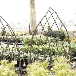 Terrain Gothic Arch Trellis - A natural take on a traditional garden design, this woven trellis boasts a network of arches to support flowering clematis and sweet pea vine. A staked base provides a secure placement in the soil.