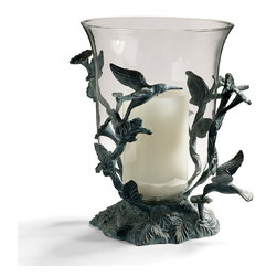 "Frontgate - Hummingbird Hurricane - Frontgate exclusive. Adds atmosphere to a side table, buffet or dining table. Coordinates well with our brass hummingbird tealight holder. Durable cast-aluminum frame with powdercoating that protects it from the elements. Glass hurricane insert measures 9"" dia. x 11""H. As totems representing joy and the enjoyment of life, hummingbirds bring positive spirit to this elegant Hummingbird Hurricane. Artisans hand-apply a verdigris finish and gold highlights to the cast-aluminum frame. The glass hurricane insert holds a 4"" x 6"" candle (sold separately). . . . . . Rubber stopper on glass bottom protects the bowl when resting in its holder. For outdoor or indoor use. Hand wash glass and used a soft, damp cloth to clean frame."
