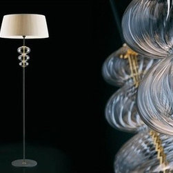 """Vintage - Musa Floor Lamp - Learn more about Musa Floor Lamp below: FEATURES   SPECIFICATIONS FEATURES:  -Finish: Chrome. -Transparent crystal glass """"torcion"""". -Unique hand blown Murano glass. -Suitable for lobby, living room. -UL Listing: Dry. Back to top SPECIFICATIONS: -Accommodates (1) 150 watt (E27) incandescent medium base bulb (not included). -Overall dimensions: 70.88"""" H x 23.63"""" W."""