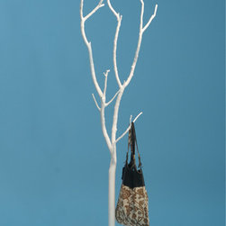 Ghost Tree - I love the mixture of organic and modern lines in this coat rack. The branches look so delicate, but the strong resin reinforced with steel rods will hold up even your heaviest of winter coats.
