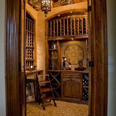 Traditional Wine Cellar by Cindy Aplanalp-Yates & Chairma Design Group