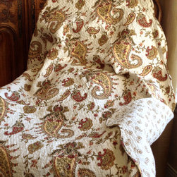 None - Paisley Quilted Throw - Enliven the home with this snuggly paisley motif throw. The throw is machine washable and showcases an intricate quilting that provides a rich surface texture.