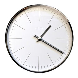 Junghans - Max Bill Wall Clock with Lines by Junghans - The Ameico Max Bill Wall Clock with Lines adds a note of elegant industrialism while providing the time with easy-to-see long lines. The Wall Clock with Lines was designed by Max Bill and is offered by Ameico.Ameico, headquartered in Connecticut, hosts original works by contemporary designers, offering an array of well-designed products for modern sensibilities.The Ameico Max Bill Wall Clock with Lines is available with the following:Included Features:Metal with Glass.Mechanical movements.Requires one AA Battery, Not Included.