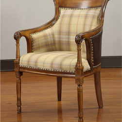None - Wilshire Accent Chair - Update your home decor with this stylish Wilshire accent chair. Stylish plaid on the inside and faux leather on the outside combine with a chestnut finish to highlight this handsome accent chair.