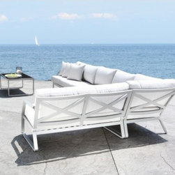 Cast Aluminum Sectional Sofa - The sleek design of this cast aluminum sofa is very appealing and very stylish. It's a comtemporary piece that isn't too bare.