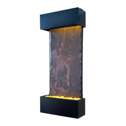 Bluworld - Medium Nojoqui Falls Lightweight Slate Fountain - Black Onyx - This smaller lightweight version of the original Large Nojoqui Falls wall fountain is named after the beautiful 164 foot tall Nojoqui Falls waterfall, located in central California where the Water Wonders line was originated. These water fountains are a truly unique, engaging and an elegant addition to any indoor space. Redesigned, the Medium Nojoqui Falls fountain includes long-lasting super bright white LED lights rated for over 10,000 hours of use and an ergonomic finger slide remote control to easily dim or brighten the LED lights or turn them on and off. This water fountain glistens as water sheets over the genuine multi-color Indian Rajah Slate flowing past polished river rock creating a soothing sound and beautiful focal point for any room. This fountain is engineered with Bluworld's clog-free, splash-free design and features the Water Wonders NSI�� genuine light weight Slate. Installation is super easy with the lightweight nature of the NSI�� slate panels. Simply hang on the wall per the instructions.This water fountain can be customized with your logo. Etched and hand-painted logos start at only $395.00. Contact our sales department for more information at 1-888-499-5433.The Medium Nojoqui Falls fountain is the perfect size to hang on just about any wall, and it will instantly raise the level of class in any living room, foyer, office or lobby. These indoor water falls come with a choice of four finishes: Standard colors; Copper Vein and Black Onyx and premium finishes; Copper Patina,or Brushed Stainless Steel.Water Wonders NSI�� Light Weight Slate��- Water fountains made with our NSI�� Light Weight Slate use our patent pending technology which sheers a layer of genuine Indian Raja Slate and fuses it to composite material with the same chipped edge technique as slab slate. They are indistinguishable from a thick slab of slate. All the beauty is retained and the weight is reduced by ov