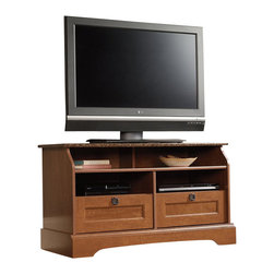 Sauder - Sauder Graham Hill Panel TV Stand in Autumn Maple - Sauder - TV Stands - 409025 - Sure lots of office and home furnishing manufacturers can help you create an organized comfortable and fashionable place to live. But Sauder provides a special kind of furniture that is practical and affordable as well as attractive and enduring. As North America's leading producer of ready-to-assemble furniture we offer more than 500 items that have won national design awards and generated thousands of letters of gratitude from satisfied consumers.