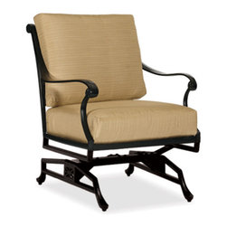 Thos. Baker - hedges motion club chair - Our hand-cast aluminum hedges collection recreates the look of classic English cast iron without the weight. Black powder-coated enamel provides a rust-free, UV-resistant finish that is extremely durable. Chair and sofa backs feature a Union Jack criss-cross motif with a center medallion.  This British flag pattern is repeated in all the table tops.