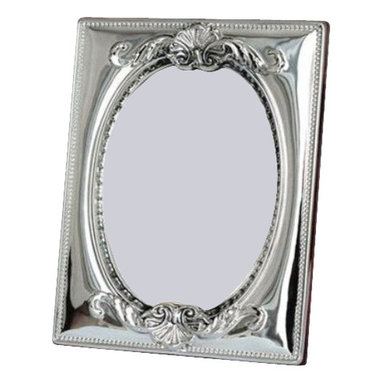 "Silverstar International - 8""x10"" Amelie II Sterling Picture Frame - Sophisticated elegance with a beautiful handcrafted embossed repouss design, our Amelie bi- laminated sterling silver picture frame features an oval inner border and a slide tab closure for easy access to your wedding photographs. This Silverstar International 925 Sterling Silver picture frame is meticulously manufactured to an aluminum base for strength & attached to a veneer mahogany wooden back and features a tarnish resistant surface for easy cleaning & glare resistant glass. Create a cherished keepsake and custom engrave that special message for the one you love."