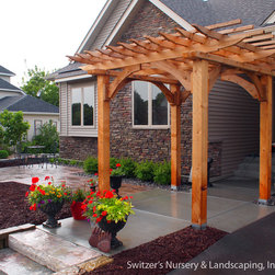 Switzer's Nursery & Landscaping, Inc. - Classic Cedar Arbor - Classic Cedar Arbor - Each and every arbor is custom designed and crafted for your project.  Enjoy the beauty of Real Cedar in your next landscape project.