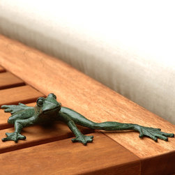 Froggy Long Legs Garden Statue - The Gumby of the frog world. He's testing his reach before he goes vertical. This piece is fashioned of cast iron with a pinch of patina and a calculated expression of wonder.
