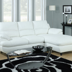 Monarch - White Bonded Leather / Match Sectional Sofa - This sleek contemporary sectional sofa will give your living room a sophisticated style. The plush and exquisitely cushioned seats and backs will keep you cozy and offer enough space for many to relax. This sectional has a lounger so you can take comfortable naps, or relax while you are watching tv. The accent stitching, sleek square wooden feet and white bonded leather add the perfect finishing touch.