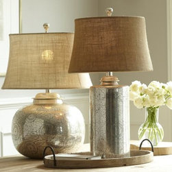 Geena Table Lamp Bases | Pottery Barn - Stylized botanical motifs are etched by hand onto these antique-silver lamps. Blackened accents highlight the intricacy of their patterns.