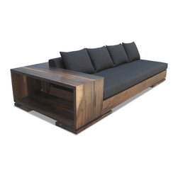 Patone Sofa - This sofa features an exposed frame featuring built in shelving, and is made with responsibly harvested solid wood from Argentina.  Shown in Guayubira, natural semi-gloss finish. Available in a wide selection of woods, any finish, and is available for shipment anywhere in the world.