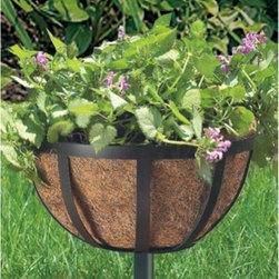 Woodstream - Black Round Coco Liner/Mild Steel English Stake Planter - SPF-B - Shop for Planters and Pottery from Hayneedle.com! The simple but elegant English Stake Planter is inspired by the sophisticated planters that grace English gardens and walkways. Portability is its finest feature along with the adjustable pole that can be set in four height positions. Finally full sun or shade plants can thrive in perfect growing conditions regardless of ground conditions - a basket of geraniums can emerge from the center of a strawberry patch. Decorate walks and driveways for curb appeal or scatter planters throughout your garden to add style to your backyard living. The English Stake Planter is made of weather-resistant black steel and comes with an eco-friendly natural coco liner that promotes healthy plant growth.About Woodstream and CobraCo A privately held company with a long-standing positive reputation Woodstream is a global manufacturer and marketer of quality products from pets and wildlife control and home and garden products to bird feeders and garden decor. They have a 150-year history of excellence growth and innovation and have built a strong presence in key markets through organic growth and strategic acquisitions. Most recently Woodstream acquired CobraCo which offers an extensive line of planters baskets flower boxes and accessories. The growth of Woodstream is thanks to their customer-driven approach to product development a dedicated design organization that focuses on innovation quality and safety as well as a commitment to an industry-leading level of service.